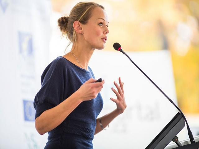 Woman speaking at a podium